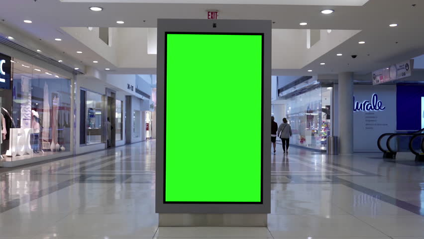 Vancouver, BC, Canada - May 17, 2017 : Motion of people shopping and green screen billboard in the middle inside Vancouver shopping mall with 4k resolution