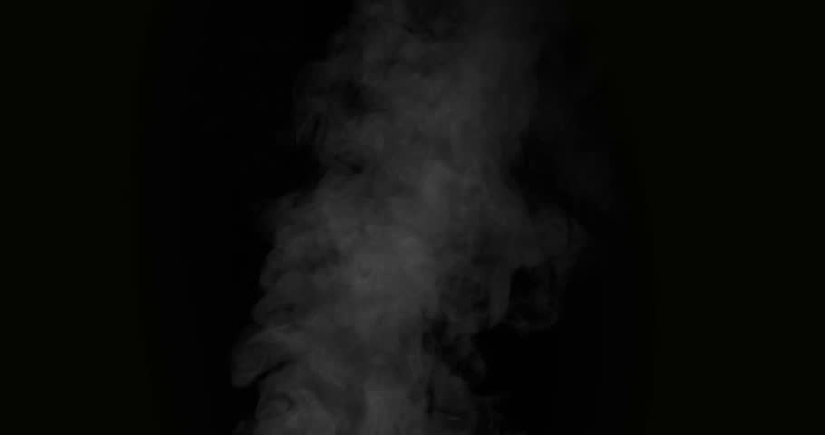 Slow Jet of Hot Steam. White Steam rises from a large pot that is behind the scenes. Black background. Filmed at a speed of 120fps #29063359