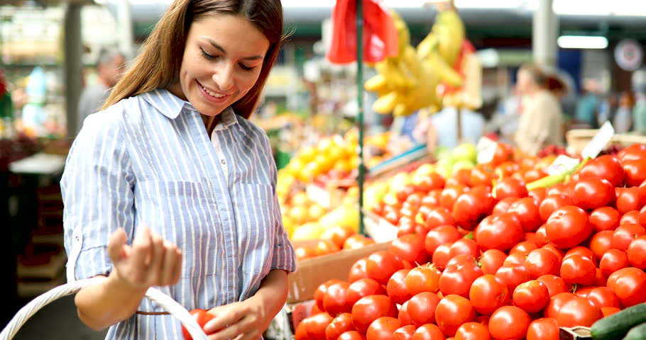 Picture of woman at marketplace buying vegetables   Shutterstock HD Video #29068399