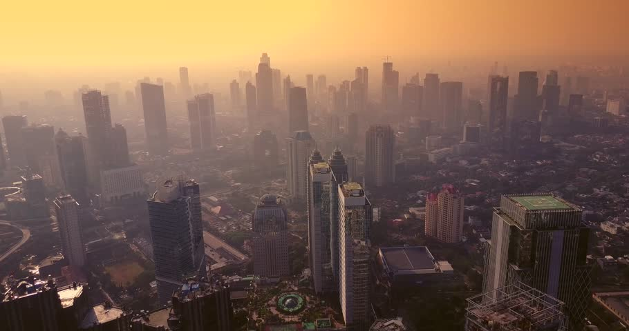 Aerial view of cityscape of Jakarta with skyscrapers at dusk time, shot in 4k resolution