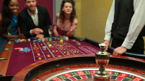 Man winning at roulette in casino
