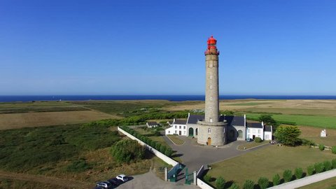 Flying over the lighthouse Le Grand Phare, named also Phare de Goulphar, located in the island of Belle-Île-en-Mer, Morbihan, Brittany, France. It is a granite tower, designed by Augustin Fresnel.
