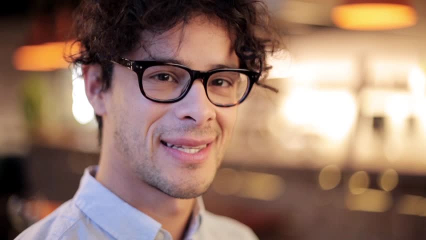 People, emotion and facial expression concept - face of happy smiling man in glasses | Shutterstock HD Video #29103949