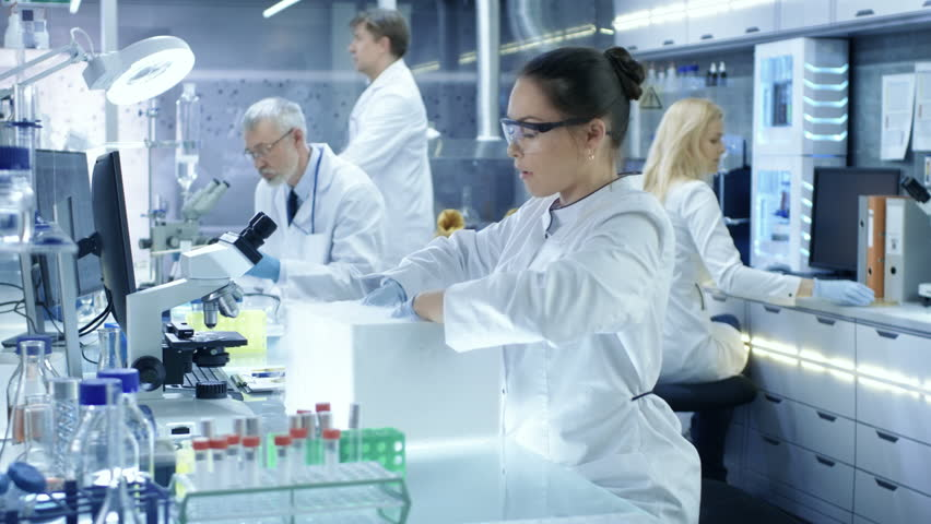 Medical Research Scientist Opens Refrigerator Box Takes Out Petri Dish with Samples and Examines it. She Works in a Busy Modern Laboratory Center. Shot on RED EPIC-W 8K Helium Cinema Camera. | Shutterstock HD Video #29109019