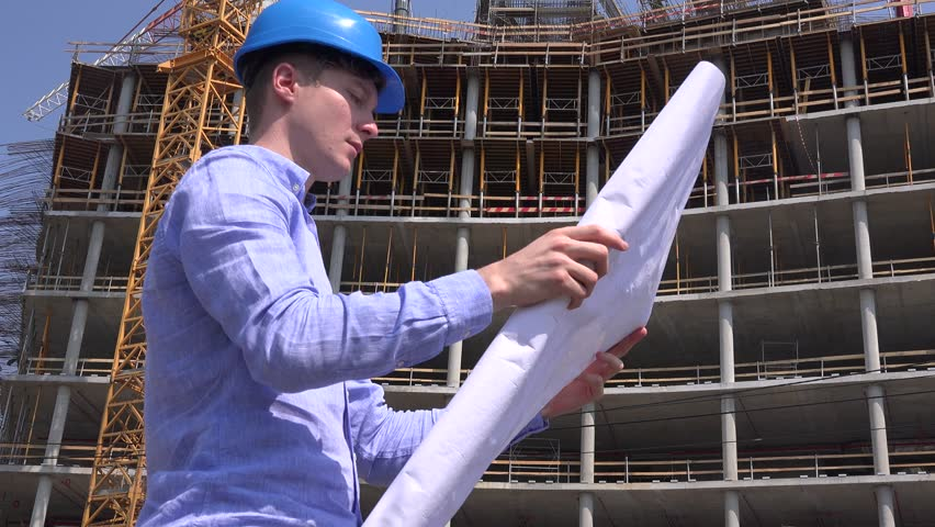 Architect profession reading blueprint construction plan builder smiling cheerful pleased architect job reading blueprint paper checking building 4k stock video clip malvernweather Image collections