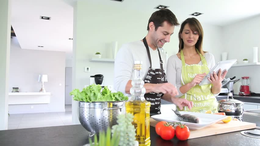 Home Kitchen Cooking middle-aged couple having fun cooking together stock footage video