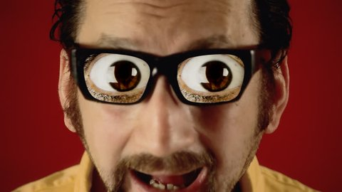 A funny ugly man with hypnotic glasses, looking at a flickering neon sign over a wall, with the text Sex. A pair of popping eyes appears soon after.