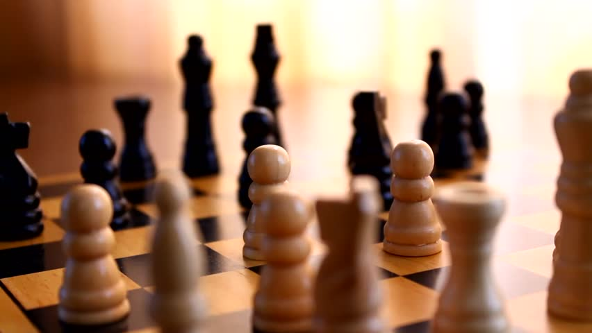 Playing chess, closeup, wooden chess board on a table