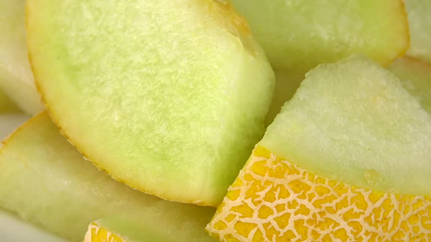 Honeydew Melon (chopped) as seamless loopable rotating 4K UHD footage