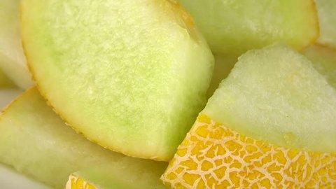 Honeydew Melon (chopped) as seamless loopable rotating 4K UHD footage