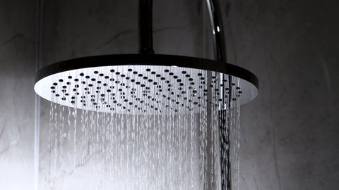 Shower flowing in close-up and slow motion