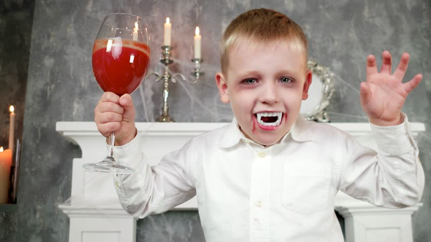 vampire boy, child in dracula costume with glass of blood, halloween costume, dangerous child,