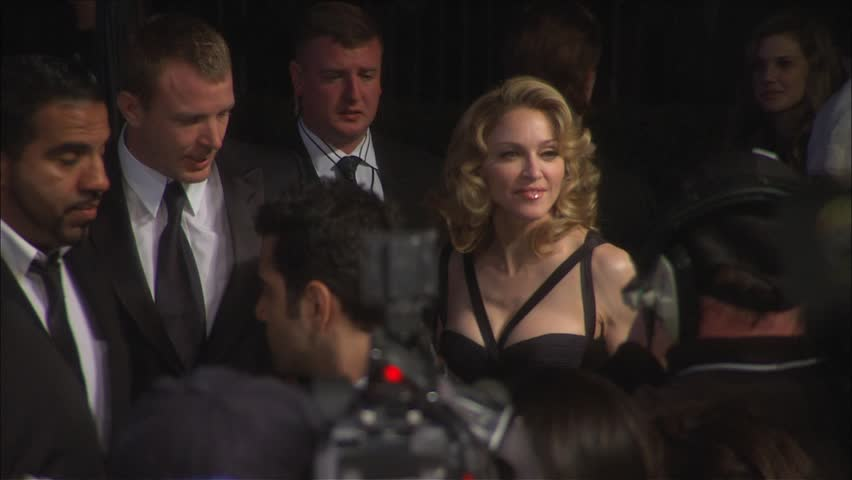Los Angeles, CA - FEBRUARY 25, 2007: Madonna, Guy Ritchie, walks the red carpet at the Vanity Fair 2007 held at the Morton's The Steakhouse | Shutterstock HD Video #2926639