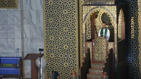 SURABAYA, INDONESIA - APRIL 2017: Imam gives a speech before Friday prayer in Surabaya, Islam religion in Indonesia