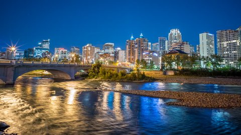 Calgary river time lapse of skyline at night 4k 1080p - Time lapse of the bow river in downtown calgary alberta