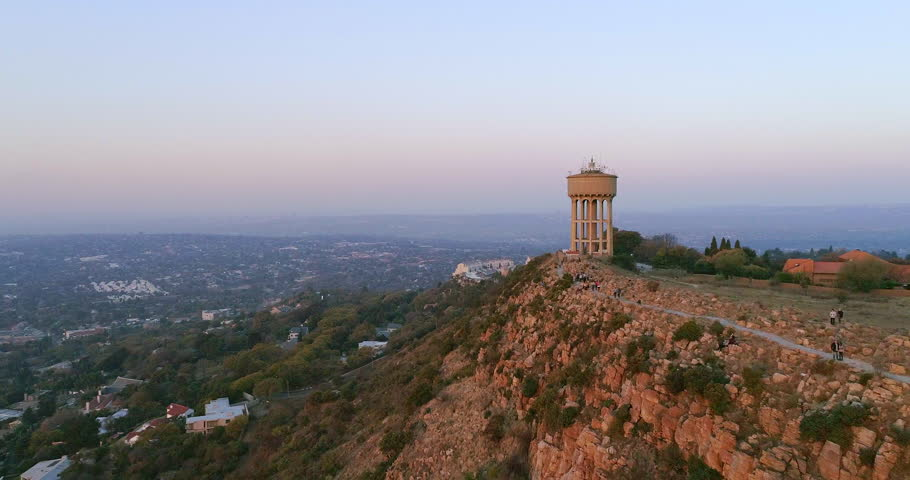 An aerial shot of the water tower atop Northcliff Hill, the second highest point in Johannesburg, South Africa shot at sunset. In the background, Sandton and a large part of Randburg can be seen.