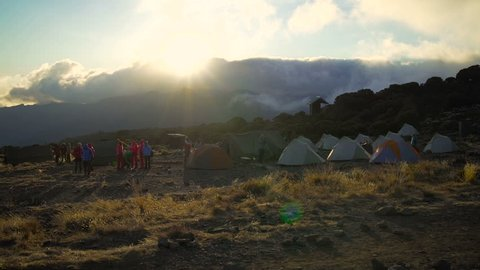 Sunset at Shira Huts Camp, Kilimanjaro. Africa, Tanzania. Kilimanjaro Summit Climb Trip. Sunset from Shira camp. Shira camp on Machame route Mount Kilimanjaro.rain forest in Africa. Jungle sunset