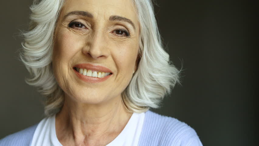 Portrait of happy old woman with eyeglasses smiling and looking at camera. Indoor shot. Close up. | Shutterstock HD Video #29339869