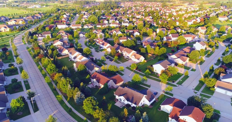 Beautiful suburban homes, Summertime aerial view at sunrise.