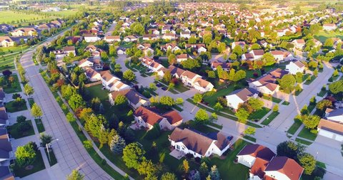 Beautiful suburban homes, Summertime aerial view at sunrise.