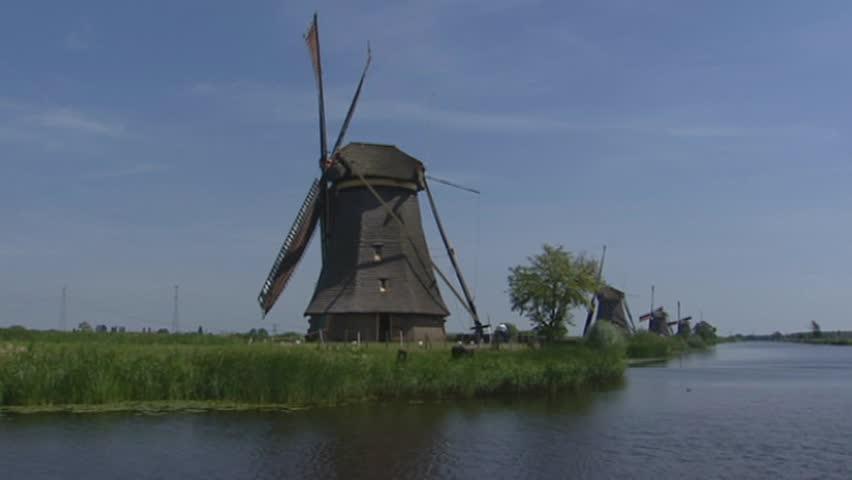 KINDERDIJK, THE NETHERLANDS  - JULY 2003: Kinderdijk windmills in polder, vehicle shot boezemvaart. Officially designated by UNESCO as World Heritage Site