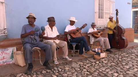 TRINIDAD, CUBA - FEBRUARY 2017: Classic Cuban band plays traditional music on the cobbled streets of historic Trinidad town