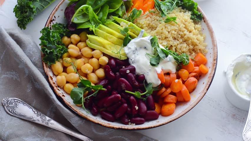 Vegan Buddha bowl with quinoa and chickpea | Shutterstock HD Video #29431819