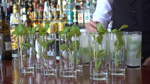 HAVANA, CUBA - FEBRUARY 2017: Closeup of bartender mixing mojitos in the Hotel Nacional in Havana, Cuba