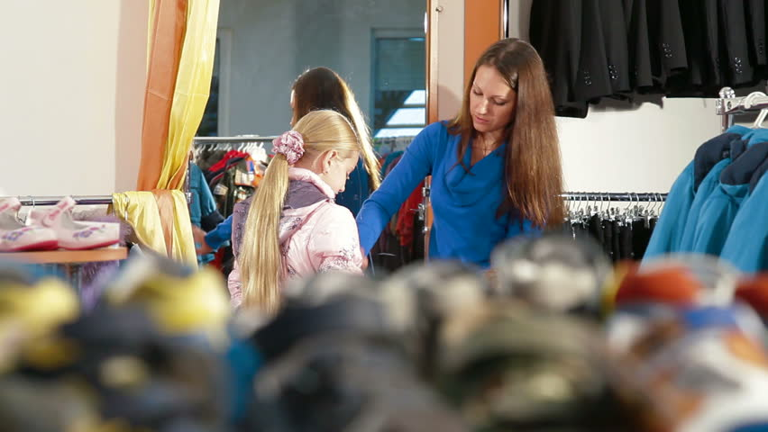 48b446c09 Family Shopping for Childrens Clothes Stock Footage Video (100 ...