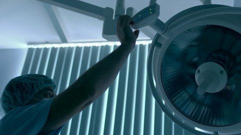 surgeon turns on light in hospital room