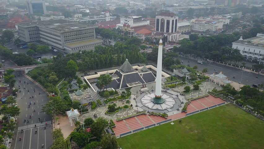 SURABAYA, INDONESIA - APRIL 2017: Aerial view of Tugu Pahlawan building and park in Surabaya, Indonesia
