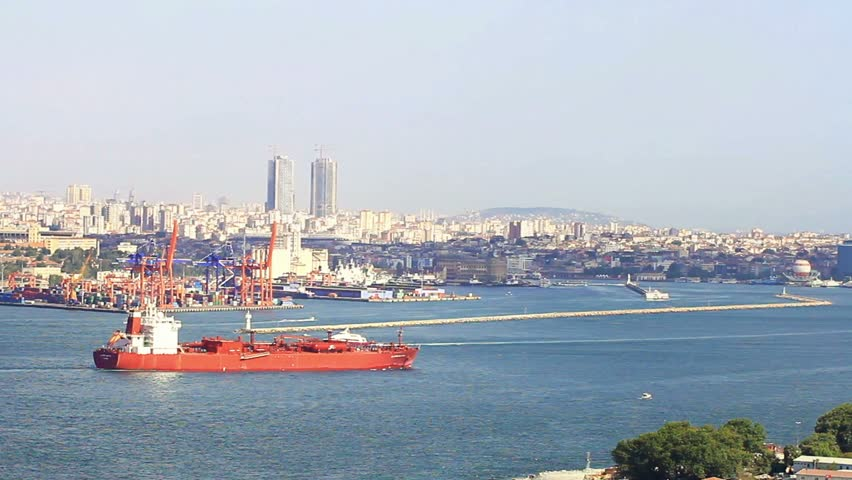 Bulk carrier ship sailing in front of Haydarpasa Seaport, Istanbul. Dry Cargo Ship sailing into Marmara Sea
