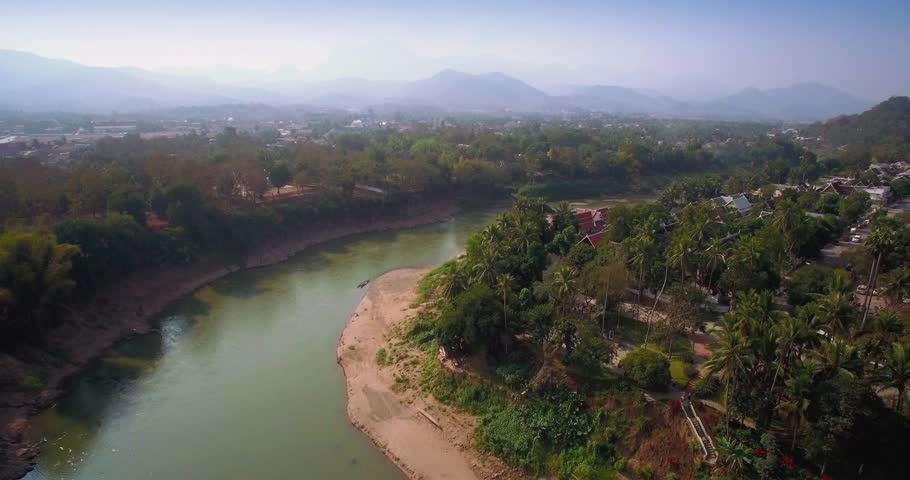 Historic Luang Prabang on the Mekong River in Laos, Ascending Drone Shot