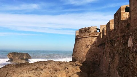 "The rough Atlantic waterfront of Essaouira, formerly known as Mogador, in the western Moroccan region of Marrakesh-Safi, on the Atlantic coast. The name means ""the little rampart"""