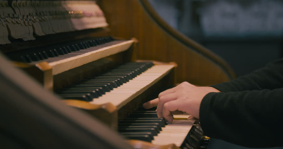 Image result for person on piano in church
