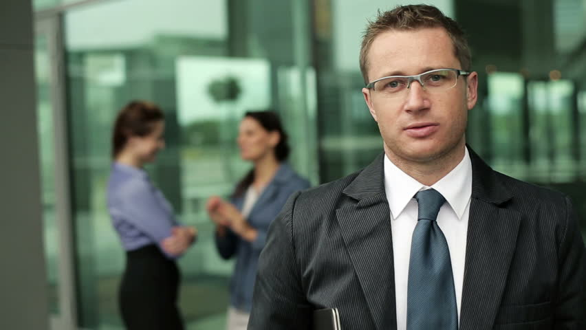 Young businessman talking to camera, steadicam shot  | Shutterstock HD Video #2955349