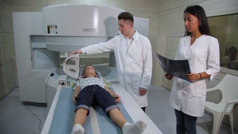 VINNITSA, UKRAINE, JULY 27, 2017: Magnetic resonance imaging. A child before a medical procedure in a ct-scanner. The child is scanned on a tomograph.