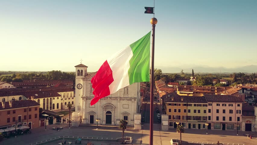 PALMANOVA, ITALY - AUGUST 9, 2017. Aerial time lapse of waving Italian flag in the very center of the town