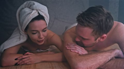 Beautiful couple relaxing while taking a sauna. Shot in Red Epic Dragon