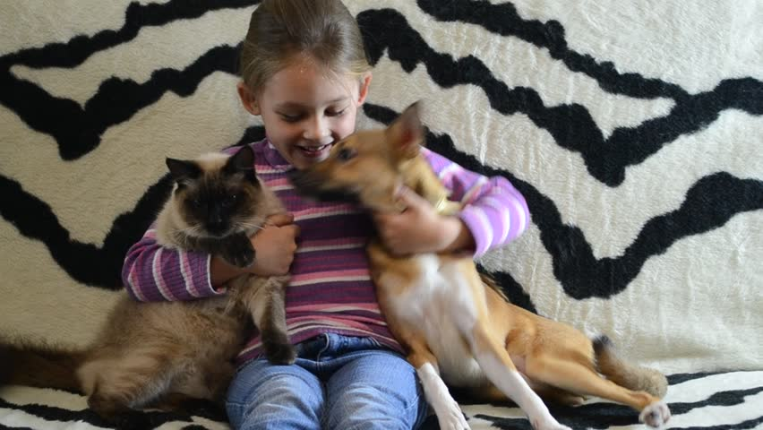 little girl with a puppy and a kitten