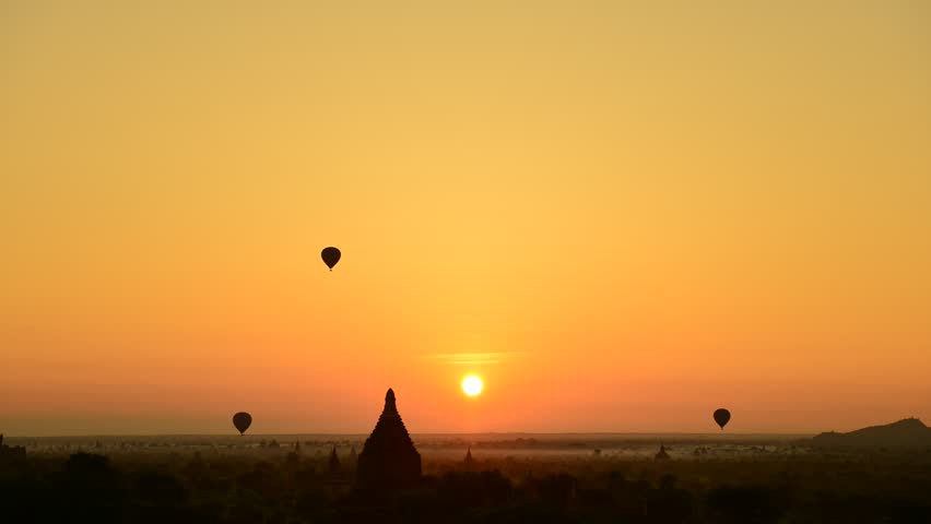 Hot air balloon and sunrise panorama view over temples of Bagan in Myanmar