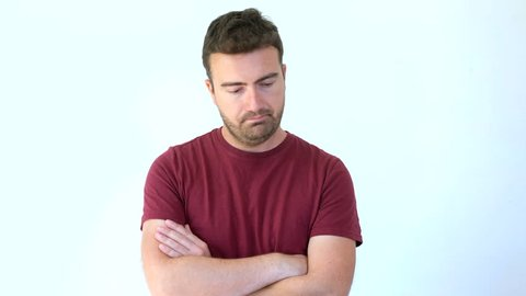 Doubtful and skeptical man isolated on background