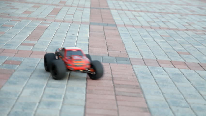 Radio-controlled car drives on city Avenue