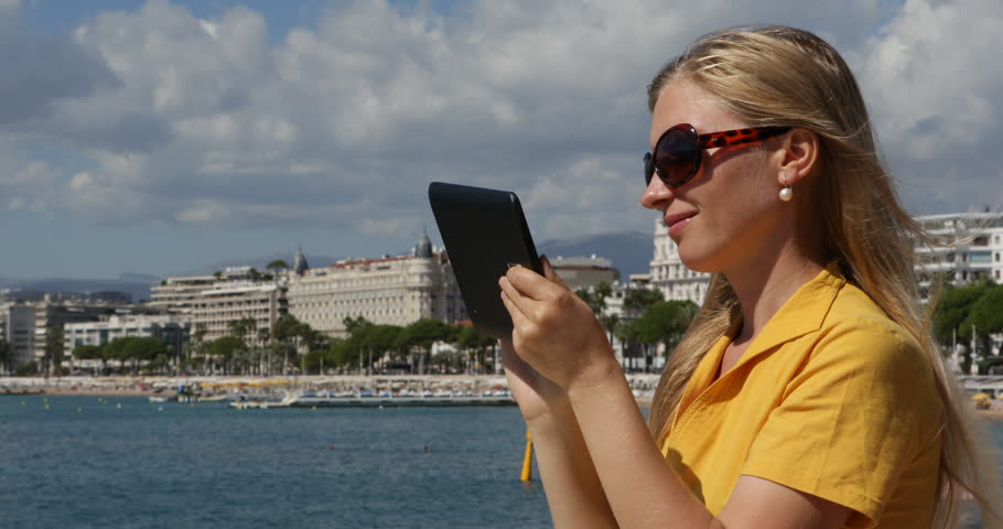 Optimistic Business Woman Working On Digital Tablet Device, Outdoor Cannes City View | Shutterstock HD Video #29729629
