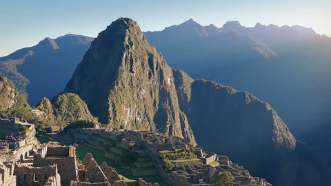 Pan From Sun Rise To Ancient Ruins On Mountainside