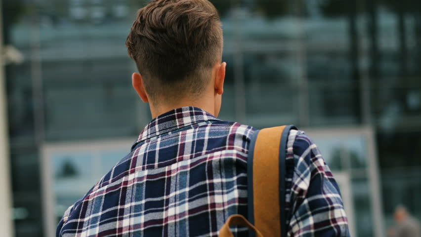 Portrait shot of young man walking to the modern airport terminal for his flight. View from the back. Close up. | Shutterstock HD Video #29743099