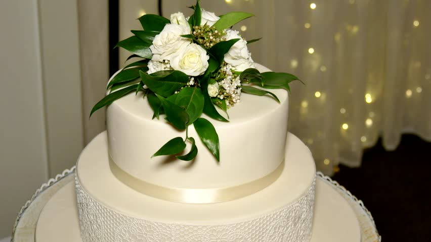Wedding decorations with flowerserior of a wedding hall close up shot of a beautiful wedding cake 4k stock video clip junglespirit Gallery