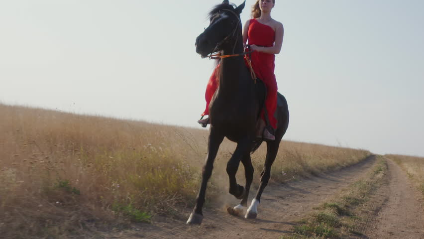 Young Girl Wearing Long Red Dress Riding Black Horse In -4731