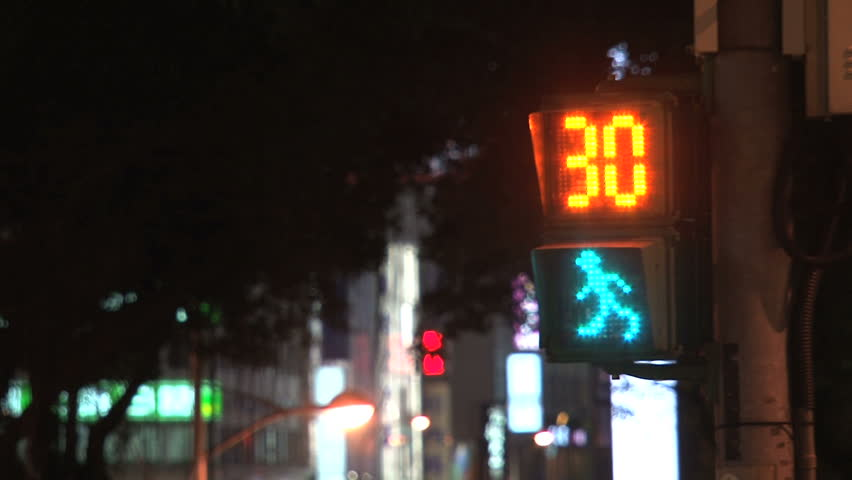 TAIPEI, TAIWAN - CIRCA 2012: Taipei traffic light counting down in seconds with walking green figure