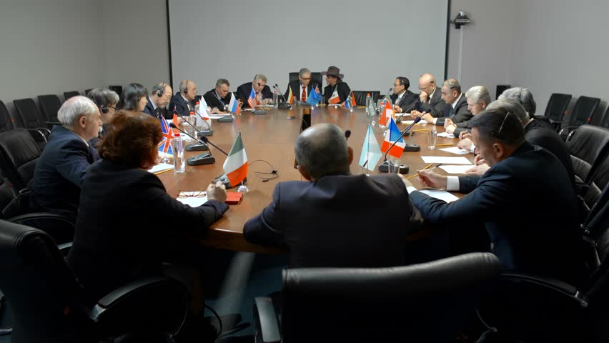 International negotiations for a round table. Statesman or politicians are seriously discussing the problem of ecology